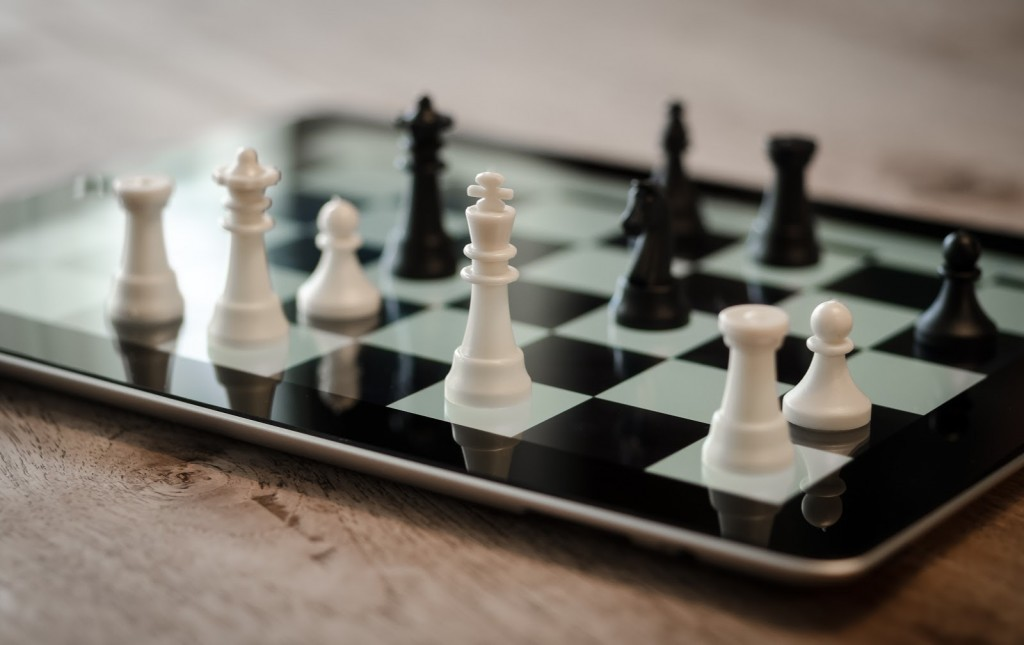 Canva_-_Playing_Chess_on_Digital_Tablet