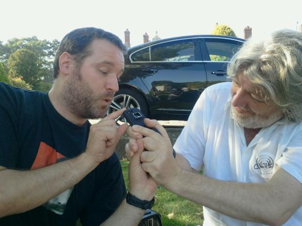 Billt and Documentally fighting over a beer bottle opener