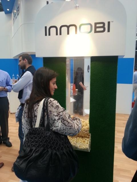 An AD:TECH delegate sampling the InMobi popcorn.